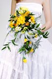 Bride and wedding bouquet Stock Image