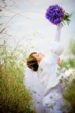 Bride with wedding bouquet Stock Photos