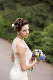 Bride with wedding bouquet in hand Royalty Free Stock Photography