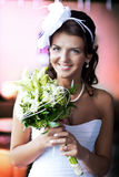 Bride with a wedding bouquet in hands Stock Images
