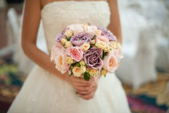 Bride with wedding bouquet in park Royalty Free Stock Image