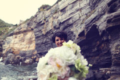 Bride with wedding bouquet on the shore Royalty Free Stock Photography