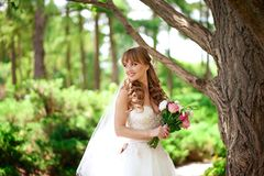Bride with wedding bouquet is smiling royalty free stock photos