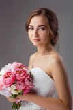 Bride with wedding bouquet studio shooting Stock Image