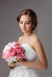 Bride with wedding bouquet studio shooting Royalty Free Stock Photos