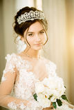 Bride. Wedding. The bride in a short dress with lace in the crow Stock Photo