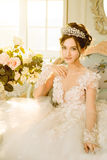 Bride. Wedding. The bride in a short dress with lace in the crow Royalty Free Stock Images
