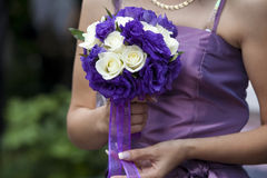 The bride with a wedding bunch of flowers Royalty Free Stock Photo