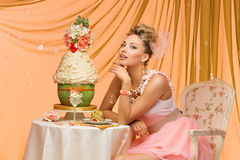 Bride with wedding cake Stock Photography