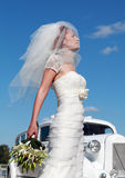 The bride and the wedding car. Bride on the background of the wedding car Stock Images