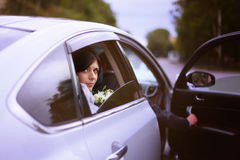 Bride in  wedding car Stock Photography