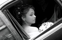 Bride in wedding car limousine Royalty Free Stock Image