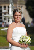 Bride on wedding day. Holding bridal bouquet flowers Stock Photo