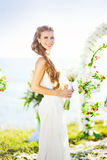 Bride on wedding day. Beautiful bride near the arch of flowers Stock Images