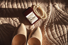 Bride wedding details - wedding shoes. Diamond ring, macaroon, parfume Royalty Free Stock Photo