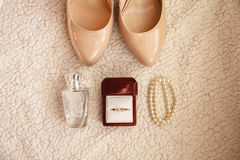 Bride wedding details - wedding shoes. Diamond ring, macaroon, parfume Stock Images