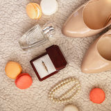 Bride wedding details - wedding shoes. Diamond ring, macaroon, parfume Stock Image
