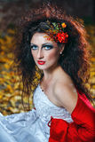 Bride in wedding dress. Attractive bride in a wedding dress with bright makeup, red shawl Royalty Free Stock Photography
