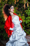 Bride in wedding dress. Attractive bride in a wedding dress with bright makeup, red shawl Royalty Free Stock Images