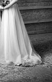 Bride in wedding dress in a barn. Black and white. Bride in wedding dress in a wooden barn. Black and white. Close-up Royalty Free Stock Photography