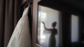 Bride and wedding dress. In bedroom stock video