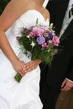 Bride, wedding dress and bouquet Stock Image