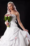 Bride in a wedding dress with a bouquet of tulips Stock Image