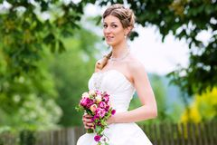 Bride in wedding dress with bridal bouquet Stock Photo