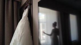 Bride and wedding dress. In bedroom stock video footage