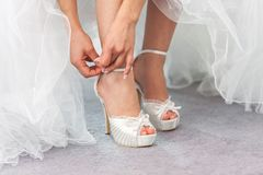 Bride closing wedding shoe belt royalty free stock photo