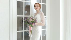 Bride enters the room. Bride in the wedding dress enters the room stock footage