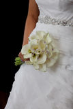 Bride in wedding dress. Holding a wedding bouquet Royalty Free Stock Photo