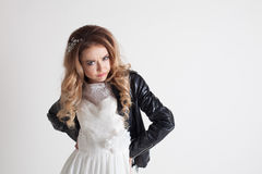 Bride in wedding dress and leather jacket Stock Photos