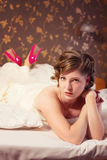 Bride in a wedding dress lies on bed Royalty Free Stock Image
