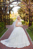 Bride in wedding dress with a long train stock photography