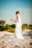The bride in a wedding dress in the middle of the desert Royalty Free Stock Images