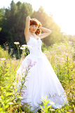 bride in a wedding dress on the nature Stock Photos