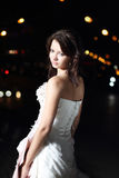 Bride in wedding dress in the night city Royalty Free Stock Photo