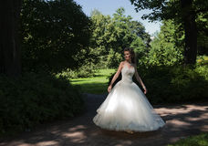 The bride in a wedding dress in park . Stock Photography
