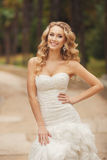 Bride in wedding dress in the Park in the summer. Royalty Free Stock Photography