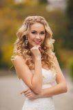 Bride in wedding dress in the park in the summer. Stock Photo
