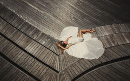 Bride in wedding dress running and having fun on tropical island of maldives Royalty Free Stock Photography