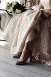 Bride in wedding dress and shoes royalty free stock image