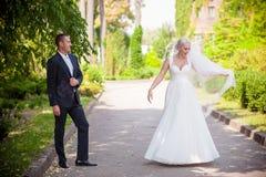 Bride in wedding dress spinning Royalty Free Stock Image