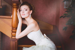 Bride in wedding dress and staircase. Bride in wedding dress around the stairs in the interior Royalty Free Stock Photography