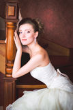 Bride in wedding dress and staircase. Bride in wedding dress around the stairs in the interior Stock Image