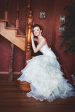 Bride in wedding dress and staircase Stock Images