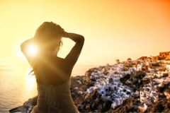 Bride in wedding dress at sunset in Santorini Greece Stock Photo