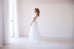 Bride in wedding dress in a white room Royalty Free Stock Photography