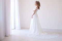 Bride in wedding dress in a white room. Before wedding Stock Photo
